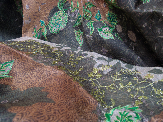 Close up details of the embroideries and the batik motives as the background